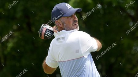 Matt Kuchar hits off the second tee during the third round of the AT&T Byron Nelson golf tournament in McKinney, Texas