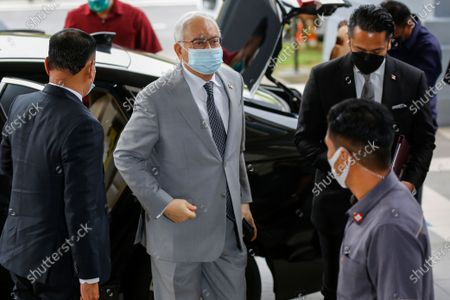 Malaysia's former Prime minister Najib Razak (L) wears a mask as he arrives at Kuala Lumpur Court Complex, Malaysia, 17 May 2021. Najib Razak arrived at Kuala Lumpur High Court to face charges linked to the state-owned firm 1Malaysia Development Berhad (1MDB).