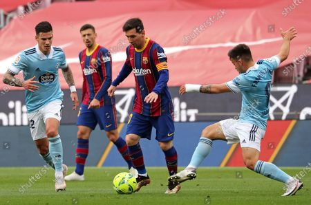 Fran Beltran, Leo Messi and Santi Mina during the match between FC Barcelona and Real Club Celta, corresponding to the week 37 of the Liga Santander, played at the Camp Nou Stadium on 16th May 2021, in Barcelona, Spain.  --