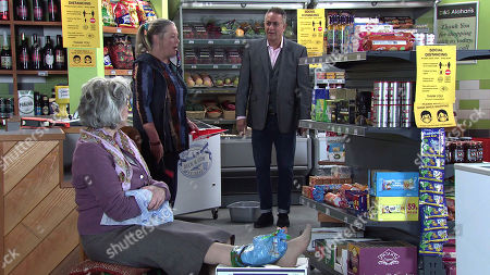 Coronation Street - Ep 10335 Wednesday 26th May 2021 - 1st Ep Evelyn Plummer's, as played by Maureen Lipman, put out to find Bernie Winter, as played by Jane Hazlegrove, working in the shop and further annoyed when she slips and falls on some spilt salad dressing. Clutching her foot in pain, Evelyn threatens to sue Dev Alahan, as played by Jimmi Harkishin, and Bernie for criminal negligence.