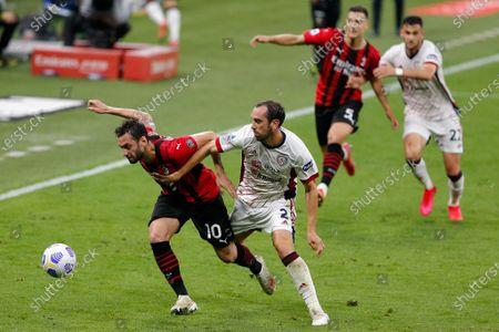 Hakan Calhanoglu (AC Milan) fouled by Diego Godin (Cagliari Calcio)
