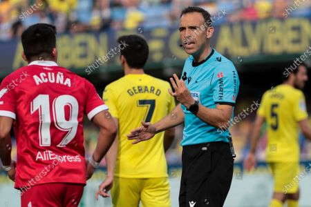 Marcos Javier Acuna of Sevilla FC (L) and Guillermo Cuadra Fernandez referee  during  spanish La Liga match between Villarreal cf and Sevilla FC  at La Ceramica   Stadium on May   17, 2021.