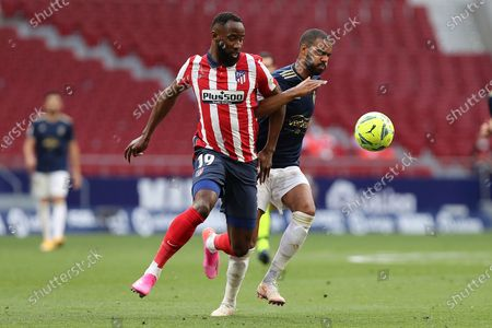 (210517) - MADRID, May 17, 2021 (Xinhua) - Atletico's Moussa Dembele (L) lives with Osasuna's Jonas Ramalho during a Spanish league football match between Atletico de Madrid and CA Osasuna in Madrid, Spain, on May 16, 2021.