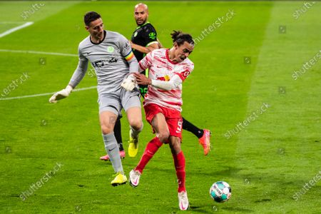 (210517) - LEIPZIG, May 17, 2021 (Xinhua) - Yussuf Poulsen (R) of Leipzig lives with goalkeeper Koen Casteels (L) of Wolfsburg during a German Bundesliga match between RB Leipzig and VfL Wolfsburg in Leipzig, Germany, May 16, 2021.