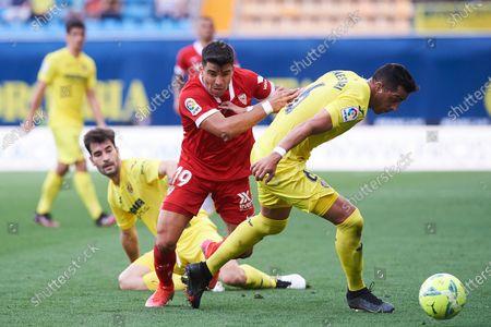 Marcos Acuna of Sevilla and Ramiro Funes Mori of Villarreal CF