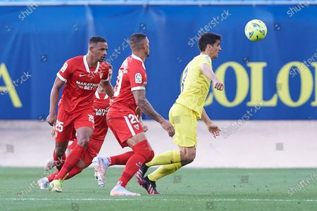 Gerard Moreno of Villarreal CF and Diego Carlos Santos Silva of Sevilla