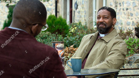 Emmerdale - Ep 9049 Monday 17th May 2021 Ethan Anderson, as played by Emile John, catches up with his dad Charles Anderson, as played by Kevin Mathurin, and tells him he's going to put the search for his mum behind him and start living life.