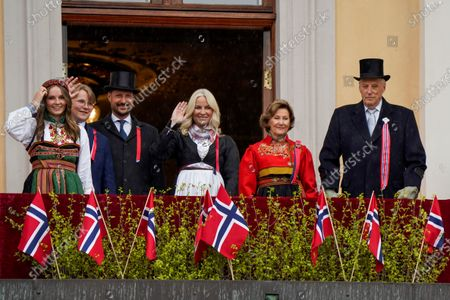 King Harald of Norway (R), Queen Sonja of Norway (2-R), Crown Prince Haakon of Norway (3-L), Crown Princess Mette-Marit of Norway (C), Princess Ingrid Alexandra of Norway (L) and Prince Sverre Magnus of Norway (2-L) greet from the balcony of the Royal Palace during the celebration of the Norwegian Constitution Day at Slottsplassen in Oslo, Norway, 17 May 2021. Due to the corona pandemic, this year is a different celebration of National Day.