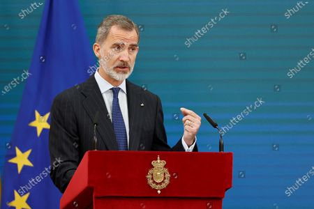 Spain's King Felipe VI (C), delivers a speech at the opening of 2020 Spanish Research Prizes awarding ceremony, at El Pardo Palace, in Madrid, Spain, 17 May 2021.
