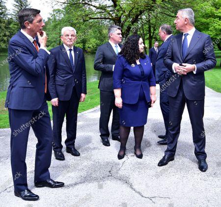 (L-R) Slovenian President Borut Pahor, Members of the Bosnian Presidency Sefik Dzaferovic, Croatian President Zoran Milanovic, Republic of Kosovo Vjosa Osmani-Sadriu, Members of the Bosnian Presidency Milorad Dodik, Montenegrin President Milo Djukanovic walk on the sideline of their Brdo-Brijuni Process summit in Brdo pri Kranju, Slovenia, 17 May 2021. The Brdo-Brijuni Process was initiated at the presidential level in 2013 while prime-ministerial meetings began in 2011 to focus on the enlargement of the European Union with countries of the Western Balkans. The summit groups leaders from Croatia, Albania, Montenegro, Kosovo, North Macedonia, Serbia and the Bosnia-Herzegovina.
