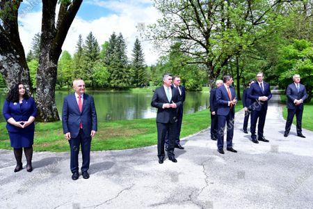 (L-R) President of the Republic of Kosovo Vjosa Osmani-Sadriu, Albanian President Ilir Meta, Croatian President Zoran Milanovic, Members of the Bosnian Presidency Milorad Dodik, Members of the Bosnian Presidency Sefik Dzaferovic, Slovenian President Borut Pahor,  President of North Macedonia Stevo Pendarovski, Serbian President Aleksandar Vucic, Montenegrin President Milo Djukanovic, pose for photo on the sideline of their Brdo-Brijuni Process summit in Brdo pri Kranju, Slovenia, 17 May 2021. The Brdo-Brijuni Process was initiated at the presidential level in 2013 while prime-ministerial meetings began in 2011 to focus on the enlargement of the European Union with countries of the Western Balkans. The summit groups leaders from Croatia, Albania, Montenegro, Kosovo, North Macedonia, Serbia and the Bosnia-Herzegovina.