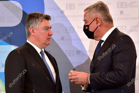 Croatian President Zoran Milanovic (L) welcomes Montenegrin President Milo Djukanovic (R) during Brdo-Brijuni Process summit in Brdo pri Kranju, Slovenia, 17 May 2021. The Brdo-Brijuni Process was initiated at the presidential level in 2013 while prime-ministerial meetings began in 2011 to focus on the enlargement of the European Union with countries of the Western Balkans. The summit groups leaders from Croatia, Albania, Montenegro, Kosovo, North Macedonia and Serbia and the Bosnia-Herzegovina.