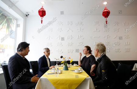 Mayor of London Sadiq Khan, second left, with chefs Angela Hartnett, second rightand Monica Galetti, right, have tea at Dumplings Legend, in China Town, central London, . Pubs and restaurants across much of the U.K. are opening for indoor service for the first time since early January even as the prime minister urged people to be cautious amid the spread of a more contagious COVID-19 variant