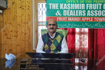 President Fruit Mandi Sopore Mr. Fayaz Ahmad Malik (Kaka Ji) is pictured at his office in Sopore, District Baramulla, Jammu and Kashmir, India on 17 May 2021. Mr. Fayaz Seek Government's Intervention for compensation of losses occurred due to bad weather conditions like Hailstorm and due to the Covid-19 Coronavirus Pandemic situation in the Valley. The apple industry is the backbone of Kashmir's economy and generates Rs 8,000 crore annually for growers and traders. According to estimates, this industry provides livelihood to 30-40 lakh souls in the region.