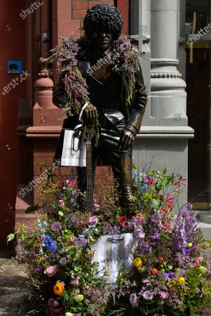 Phil Lynott statue decorated with flowers seen in Dublin city center as Ireland takes another step towards normality with all non-essential retail being allowed to resume from today.On Monday, 17 May 2021, in Dublin, Ireland.