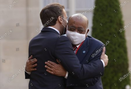 Stock Image of French President Emmanuel Macron (L) welcomes President of Mo Ibrahim Foundation, Mo Ibrahim (R), before a dinner at the Elysee Palace folowing a summit on the African Economy financing in Paris, France, 17 May 2021.