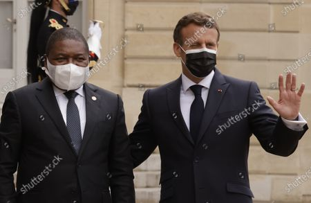 French President Emmanuel Macron (R) welcomes Mozambique's President Filipe Nyusi (L), before a dinner at the Elysee Palace folowing a summit on the African Economy financing in Paris, France, 17 May 2021.