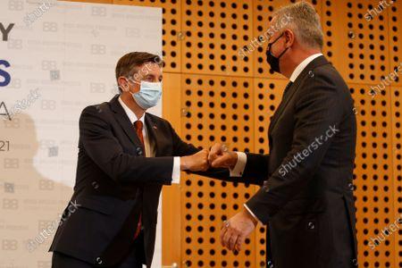 Slovenia's President Borut Pahor, left, welcomes Montenegro's President Milo Djukanovic at the Brdo-Brijuni summit, in Brdo, Slovenia, . The Brdo-Brijuni Process summit had originally been planned for last year, to coincide with the 10th anniversary of the initiative, but had been postponed twice due to the coronavirus pandemic