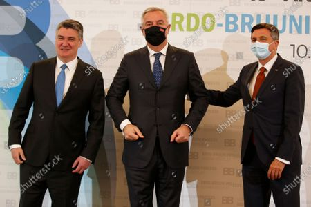 Stock Image of Croatian President Zoran Milanovic, left, and Slovenia's President Borut Pahor, right, pose for cameras with Montenegro's President Milo Djukanovic at the Brdo-Brijuni summit, in Brdo, Slovenia, . The Brdo-Brijuni Process summit had originally been planned for last year, to coincide with the 10th anniversary of the initiative, but had been postponed twice due to the coronavirus pandemic