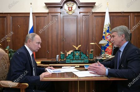 Russian President Vladimir Putin (L) and Chairman of the Management Board of Novatek Leonid Mikhelson (R) meet at the Kremlin in Moscow, Russia, 17 May 2021.