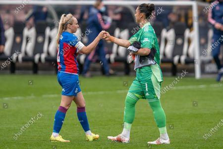 Annabel Johnson (2 Crystal Palace) and Manuela Zinsberger (1 Arsenal) at the final whistle of the Vitality Womens FA Cup 5th round match between Arsenal and Crystal Palace at Meadow Park, Borehamwood, England.