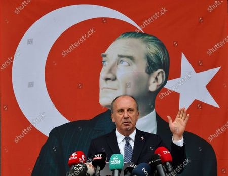 Muharrem Ince, a politician who once ran as a presidential challenger to Turkish President Recep Tayyip Erdogan, gestures as he announces his resignation from Turkey's main opposition party during a media conference in Ankara, Turkey, in front of a poster of modern Turkey's founder, Mustafa Kemal Ataturk, Ince, 56, formed a new political party, the Memleket Partisi, or Homeland Party, on Monday, May 17, 2021, months after he broke away from Turkey's main opposition party. The politician as CHP's candidate against Erdogan in Turkey's 2018 presidential election, getting 31% of the votes behind Erdogan's 53% support