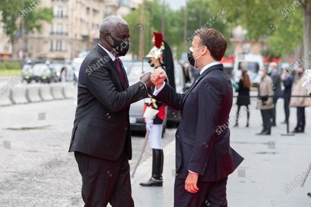 Stock Photo of France's President Emmanuel Macron (R) welcomes African Union (AU) Commission Chairman Moussa Faki French President Emmanuel Macron is waiting for an International Conference on the Sudan at the Grand Palais Ephemere. Paris, FRANCE-17/05/2021
