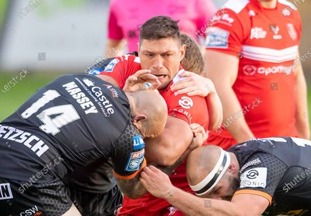 Hull KR's Ryan Hall is tackled by Castleford's Nathan Massey & George Griffin..