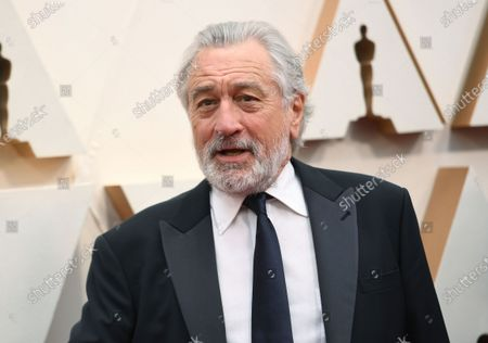 """Robert De Niro appears at the Oscars in Los Angeles on . A leg injury may keep De Niro from celebrating the 20th Anniversary of the Tribeca Film Festival in person. The accident happened last week in Oklahoma while on location for the upcoming Martin Scorsese film, """"Killers of the Flower Moon"""