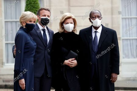 Stock Image of French President Emmanuel Macron, second from left, and his wife Brigitte Macron, left, welcome Ivorian President Alassane Ouattara, right, and his wife Dominique Ouattara, for a dinner with leaders of African states, at the Elysee Palace, in Paris, . French President Emmanuel Macron announced the cancellation of Sudan's $5 billion debt to France in an effort to support the country's transitional leadership and help its crippled economy recovering, at a Paris conference gathering African leaders and international creditors