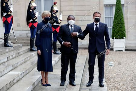 French President Emmanuel Macron, right, and his wife Brigitte Macron, left, welcome Mozambique's President Filipe Nyusi for a dinner with leaders of African states, at the Elysee Palace, in Paris, . French President Emmanuel Macron announced the cancellation of Sudan's $5 billion debt to France in an effort to support the country's transitional leadership and help its crippled economy recovering, at a Paris conference gathering African leaders and international creditors