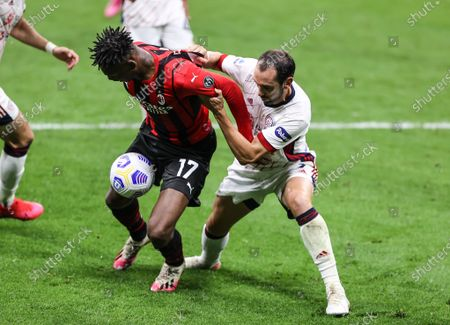 Stock Picture of Rafael Leao of AC Milan fights for the ball against Diego Godin of Cagliari Calcio during the Serie A 2020/21 football match between AC Milan vs Cagliari Calcio at Giuseppe Meazza Stadium. (Final score; AC Milan 0 - 0 Cagliari Calcio)