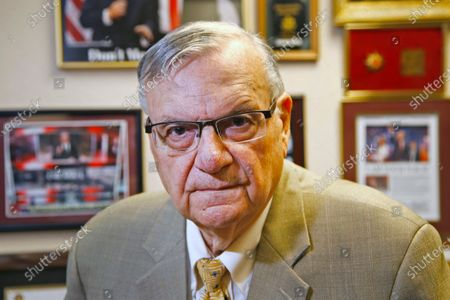 Former Maricopa County Sheriff Joe Arpaio poses for a portrait at his private office in Fountain Hills, Arizona. The taxpayer costs for the racial profiling lawsuit stemming from the immigration patrols launched a decade ago by Arpaio are expected to reach $202 million by the summer of 2022. Officials approved a tentative county budget, that provides $31 million for compliance costs in the fiscal year that begins on July 1. No one in county government can say exactly when those costs will start to decline or end