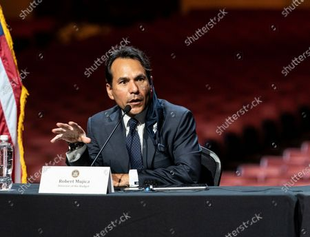 Robert Mujica speaks during Governor Andrew Cuomo announcement that the state adopts new CDC guidance and regulations at Radio City Music Hall. Effective May 19 New York State as well as Connecticut and New Jersey will adopt new CDC rules on masks and social distancing for vaccinated people. Governor also announced that the closing night of Tribeca Film Festival will be held at Radio City Music Hall with full capacity only for vaccinated people. Governor announced new rules for entertainment and sporting events, gatherings indoors and outdoors and urged people to get vaccinated. Governor stated that it is up to private companies to set additional restrictions as they like. CEO of MSG Entertainment James Dolan added that people who are vaccinated will get priority for attending events at the Garden. Joining Governor on these announcement were Executive Chairman and CEO Madison Square Garden Entertainment James Dolan, Interim CEO New York Road Runners Kerin Hempel, Co-Founder Tribeca Productions Jane Rosenthal, Director of the Budget Robert Mujica, Health Commissioner Howard Zucker