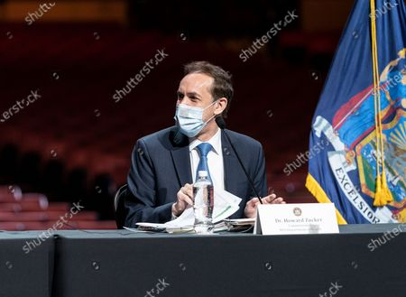 Dr. Howard Zucker attends Governor Andrew Cuomo announcement that the state adopts new CDC guidance and regulations at Radio City Music Hall. Effective May 19 New York State as well as Connecticut and New Jersey will adopt new CDC rules on masks and social distancing for vaccinated people. Governor also announced that the closing night of Tribeca Film Festival will be held at Radio City Music Hall with full capacity only for vaccinated people. Governor announced new rules for entertainment and sporting events, gatherings indoors and outdoors and urged people to get vaccinated. Governor stated that it is up to private companies to set additional restrictions as they like. CEO of MSG Entertainment James Dolan added that people who are vaccinated will get priority for attending events at the Garden. Joining Governor on these announcement were Executive Chairman and CEO Madison Square Garden Entertainment James Dolan, Interim CEO New York Road Runners Kerin Hempel, Co-Founder Tribeca Productions Jane Rosenthal, Director of the Budget Robert Mujica, Health Commissioner Howard Zucker