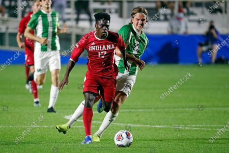 Indiana's Herbert Endeley (17) tries to break away from Marshall's Max Schneider (23) during the first half of the NCAA College Cup championship soccer match in Cary, N.C