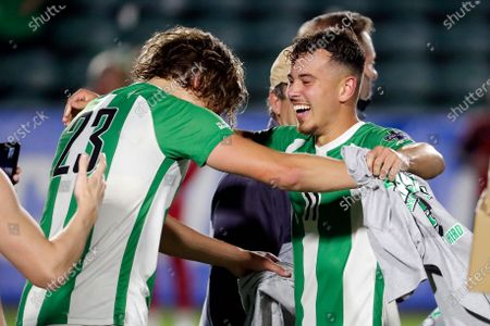Marshall's Jamil Roberts (11) and Max Schneider (23) celebrate following the team's overtime win over Indiana at the NCAA College Cup championship soccer match in Cary, N.C