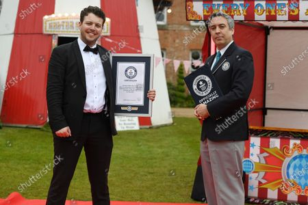 Stock Picture of James Bennewith receives his Guinness Book of Records Award for a NEW World Record