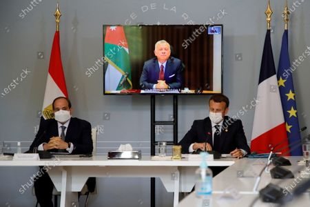 French President Emanuel Macron (R) and Egyptian President Abdel Fattah al-Sisi (L) attend video conference with Jordan's King Abdullah II ibn Al Hussein (on screen) to work on a concrete proposal for a ceasefire and a possible path to discussions between Israel and the Palestinians at the Elysee Palace in Paris, France, 18 May 2021. Tensions have escalated in the region following days of violent confrontations between Israeli security forces and Palestinians in Jerusalem, leading to the heaviest offensive in years.