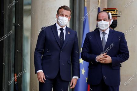 French President Emanuel Macron (L) welcomes Egyptian President Abdel Fattah al-Sisi (R) as he arrives to attend a video conference with Jordan's King Abdullah II ibn Al Hussein to work on a concrete proposal for a ceasefire and a possible path to discussions between Israel and the Palestinians at the Elysee Palace in Paris, France, 18 May 2021. Tensions have escalated in the region following days of violent confrontations between Israeli security forces and Palestinians in Jerusalem, leading to the heaviest offensive in years.