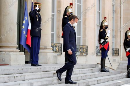 French President Emanuel Macron attends to welcome Egyptian President Abdel Fattah al-Sisi (not seen) as he arrives to attend a video conference with Jordan's King Abdullah II ibn Al Hussein to work on a concrete proposal for a ceasefire and a possible path to discussions between Israel and the Palestinians at the Elysee Palace in Paris, France, 18 May 2021. Tensions have escalated in the region following days of violent confrontations between Israeli security forces and Palestinians in Jerusalem, leading to the heaviest offensive in years.