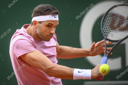 Grigor Dimitrov of Bulgaria in action during his second round match against Ilya Ivashka of Belarus at the ATP 250 Geneva Open tennis tournament in Geneva, Switzerland, 19 May 2021.