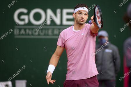 Grigor Dimitrov of Bulgaria reacts during his second round match against Ilya Ivashka of Belarus at the ATP 250 Geneva Open tennis tournament in Geneva, Switzerland, 19 May 2021.