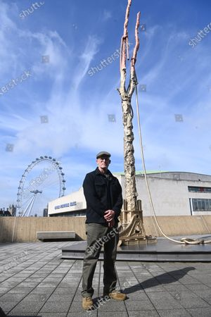 U.S. artist Matthew Barney poses for photographers next to a large scale copper, brass and stainless steel sculpture entitled 'Sawtooth Battery' during his major exhibition 'Redoubt' at the Hayward Gallery that is reopening as Covid-19 restrictions ease in London, Britain, 18 May 2021. Britain is easing some coronavirus restrictions allowing indoors locations such as pubs, museums, galleries, cinemas and adult group sports and exercise classes to reopen from 17 May. Also legal restrictions on meeting others outdoors are lifted. British Prime Minister Johnson hopes to be able to lift the majority of rules by 21 June.