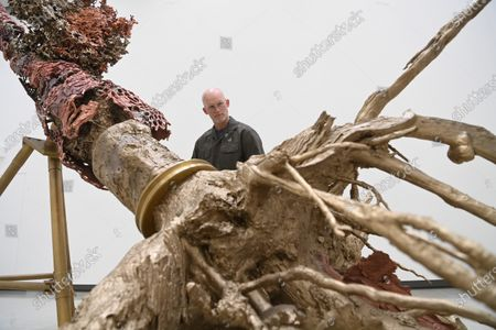 U.S. artist Matthew Barney poses for photographers next to a  large scale copper, brass and stainless steel sculpture entitled 'Diana' during his major exhibition 'Redoubt' at the Hayward Gallery that is reopening as Covid-19 restrictions ease in London, Britain, 18 May 2021. Britain is easing some coronavirus restrictions allowing indoors locations such as pubs, museums, galleries, cinemas and adult group sports and exercise classes to reopen from 17 May. Also legal restrictions on meeting others outdoors are lifted. British Prime Minister Johnson hopes to be able to lift the majority of rules by 21 June.