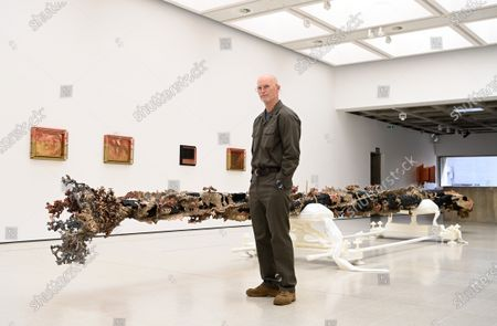 U.S. artist Matthew Barney poses for photographers next to a  large scale copper, brass and stainless steel sculpture entitled 'Elk Creek Burn' during his major exhibition 'Redoubt' at the Hayward Gallery that is reopening as Covid-19 restrictions ease in London, Britain, 18 May 2021. Britain is easing some coronavirus restrictions allowing indoors locations such as pubs, museums, galleries, cinemas and adult group sports and exercise classes to reopen from 17 May. Also legal restrictions on meeting others outdoors are lifted. British Prime Minister Johnson hopes to be able to lift the majority of rules by 21 June.