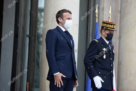 French President Emmanuel Macron after a meeting with the Mozambique President at the end of a meeting at the Elysee palace