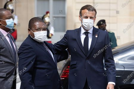 French President Emmanuel Macron with Mozambique President Filipe Nyusi at the end of a meeting at the Elysee palace
