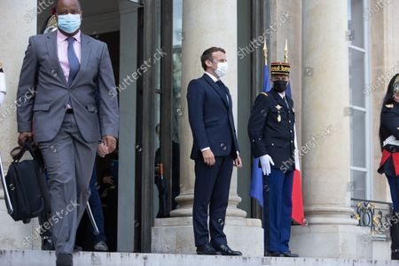 French President Emmanuel Macron after a meeting with Mozambique President at the end of a meeting at the Elysee palace