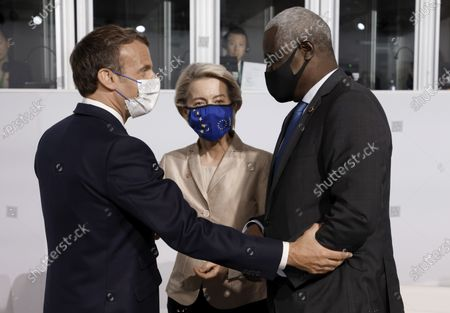 Stock Picture of French President Emmanuel Macron, left, salutes European Commission President Ursula von der Leyen and African Union (AU) Commission Chairman Moussa Faki at the Summit on the Financing of African Economies in Paris. More than twenty heads of state and government from Africa are holding talks in Paris with heads of international organizations on how to revive the economy of the continent, deeply impacted by the consequences of the COVID-19 pandemic